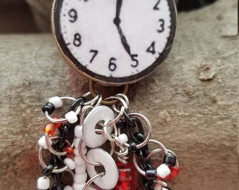 Black, white and red faux clock pendant