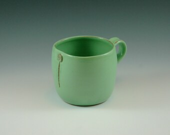 Large pistage mug with glaze.