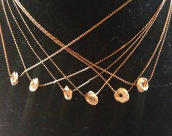 Short gold chain necklaces with simple swirl pendant