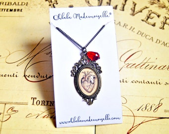 Snow White's heart handmade glass cabochon long necklace, snow white necklace, anatonical heart necklace