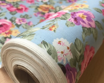 Pink Rose Floral 100% Cotton fabric on a Sky Blue background