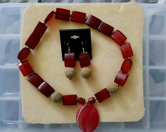 Beautiful handmade red and tan necklace and earring set.