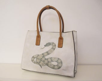 Faux leather handbag with hand painted decoration