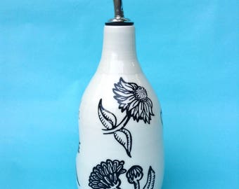 The Oil  or Vinegar white Bottle with flower patterns, with or without inscription