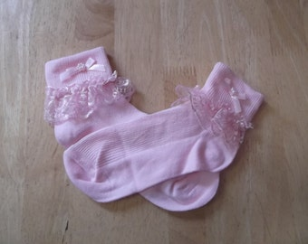 pink socks with lace trim and ribbon bow