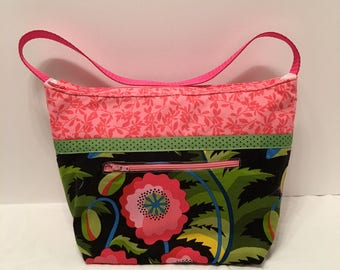 "LIP12- Lunch Bag: ""In The Pink"" washable insulated lunch bag with zippered front pocket and zippered top closure."