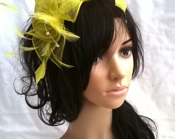 Very zesty Yellow/mid lime  rosette Sinamay and  Feather Fascinator..on a headband
