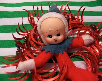 tiny elf doll with tinsel ornament