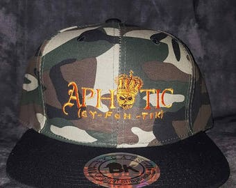 Camouflage and Black (Brim) Hat with Orange Aphotic Logo on the Front
