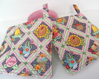 Country quilted potholders.  Garden designs. Bright colors.
