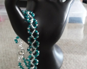 Teal and clear glass bead bracelet