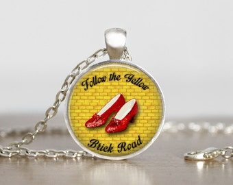 Follow the yellow brick road. Wizard of Oz. Dorothy. Fandom. Gift. Comes as a necklace or keychain.