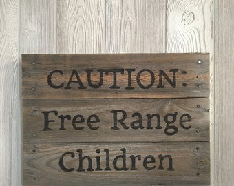 """Wood sign """" CAUTION: Free Range Children """" from recycled wood"""