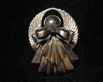 Gold tone Angel pin brooch.