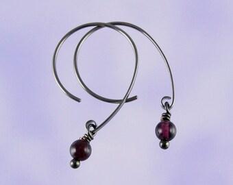 Niobium earrings: Garnet beads on Apostrophe earwires