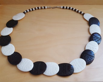 brown and cream coloured etched bone necklace