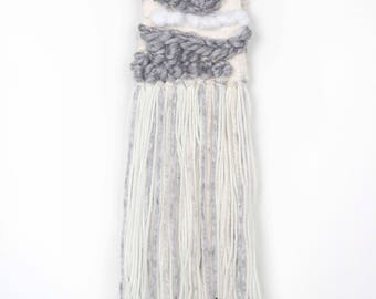 White and Grey and Silver Handwoven Weave.