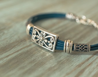 Multistrand Iris Blue Genuine Leather Bracelet with antique silver accents