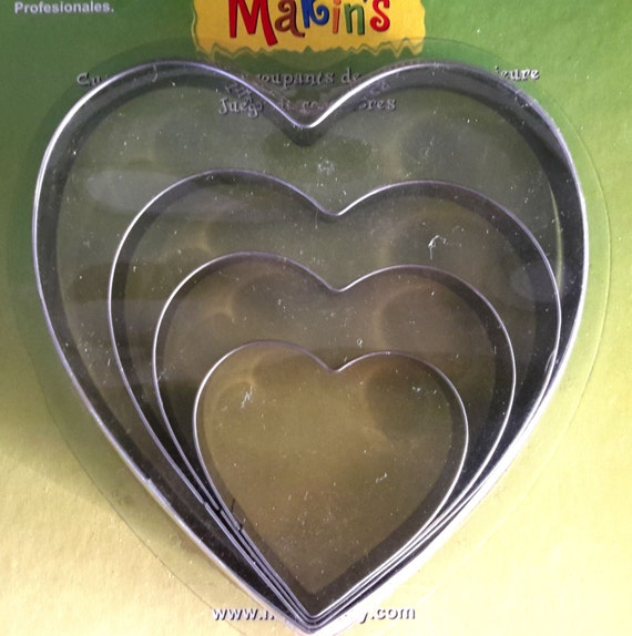 """4 piece heart stainless steel cookie cutter set with sizes from 2 1/4"""" to 5""""  tall"""