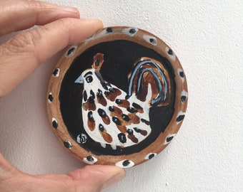 Painting on reclaimed wood of a mexican ceramic bird