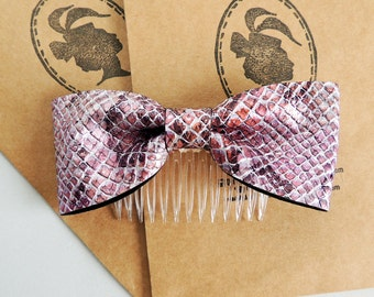 Pink and silver faux leather bow comb for hair