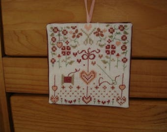 "embroidered wall hanging ""flowers, coil and heart"""