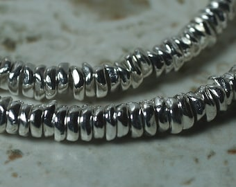 Silver tone mini chip rodelle beads aprox 4-5mm in diameter 2mm thick hole size aprox 1.5mm, 30 pcs (item ID FA2604MB)