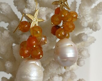 White Baroque pearl earrings, orange agate, and silver starfish
