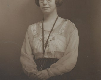 Photo Postcard of a girl wearing glasses, Real Photo Postcard, RPC, RPPC