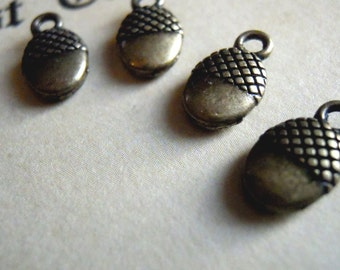 4 Small Antiqued Brass Acorns Pendants or Charms
