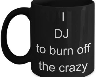 I DJ to burn off the crazy  Black Mug