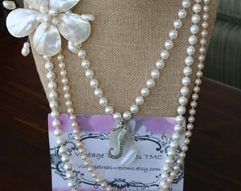 3 Strand pearl and shell assemblage necklace