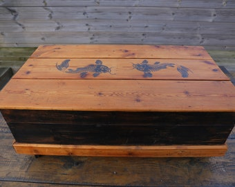 Upcycled pine chest on castors with koi carp detailing