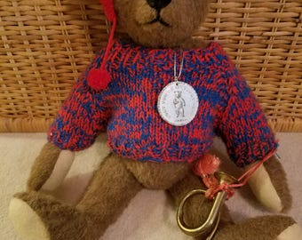 Teddy Bear with Horn, medal and stocking cap