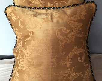 Gold pillow covers with black and gold cord