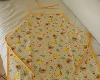 Child apron with fruit patterns, yellow bias
