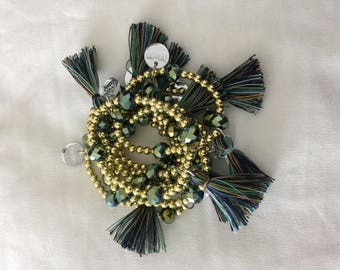 Oriental inspired bracelet with gold beaded stones and tassels