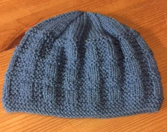 Hand knit baby hat in petrol blue. Double knit yarn. To fit from 0-3 months.