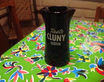 "Vintage mid-century Cluny Scotch double pitcher that says ""Taste Cluny Scotch"""