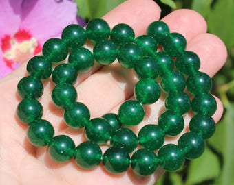 2 round Emerald beads 10 MM. A566L