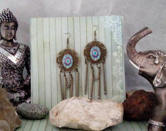 A pair of dangling earrings ethnic bronze
