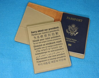 Passport Cover - Sorry about our President in 13 different languages. Great gift for those embarassed patriots!