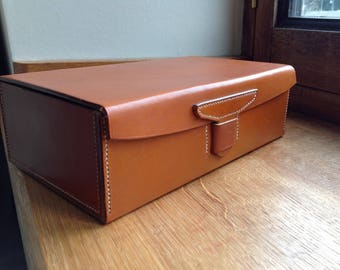 Leather box with leather clasp