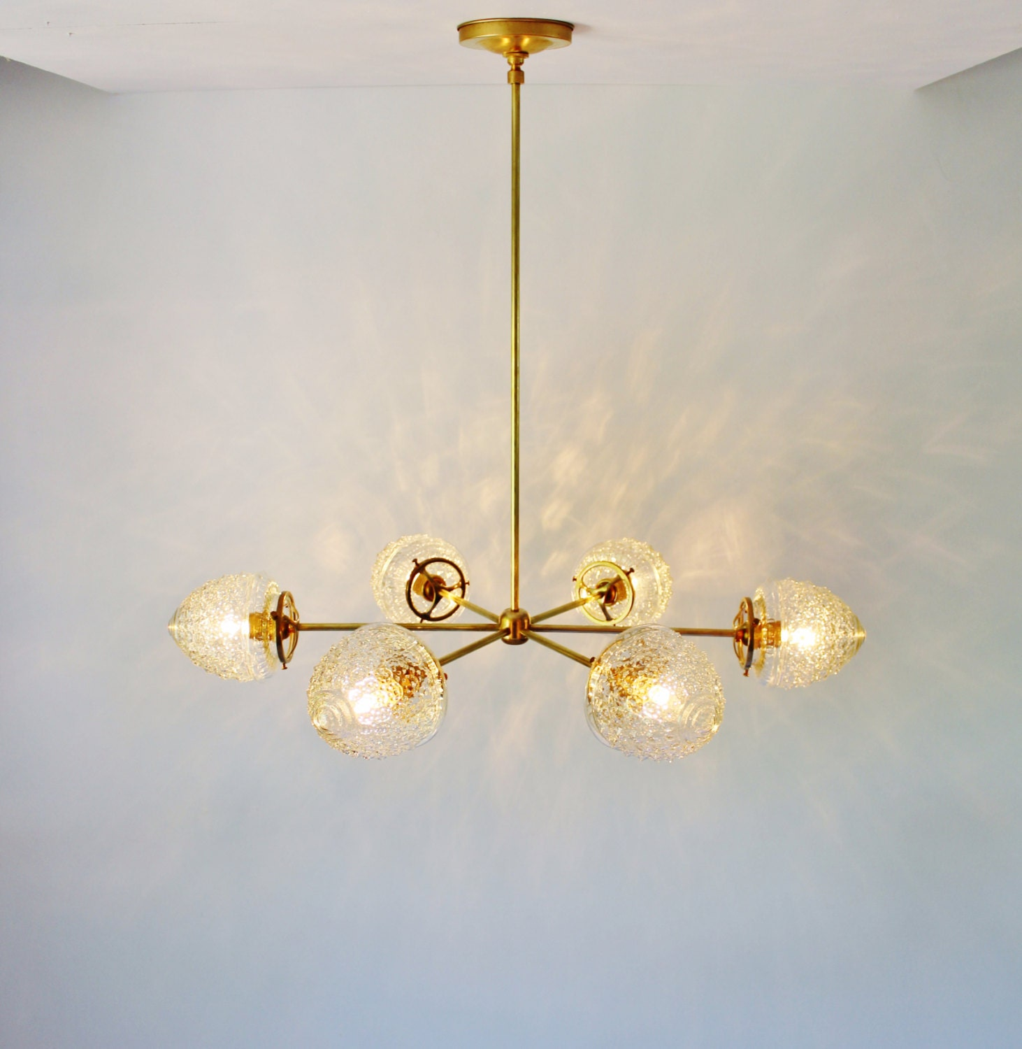 Modern brass chandelier with clear glass acorn shades 6 zoom arubaitofo Image collections