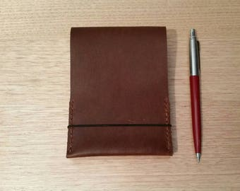 Personalized leather spiral pocket notebook cover in whisky brown cowhide.