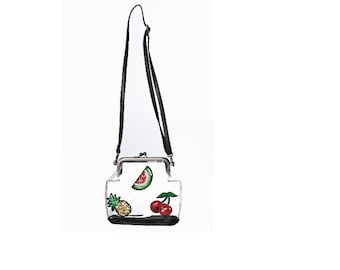 Small white shoulder bag with tropical fruit design