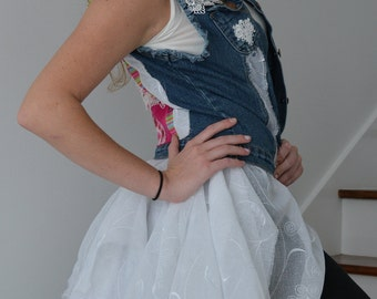 denim vest distressed attached layered skirt open in front tassels on back layered appliqués on back. ragged hem lace one of a kind