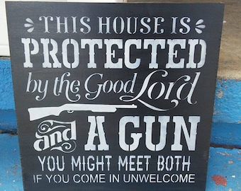 Stenciled wood sign, this house is protected by the good Lord and a gun, handmade sign