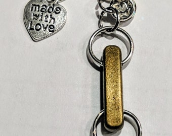Handmade keychain with gold,bronze, and silver accent charms and beads chinese crested charms