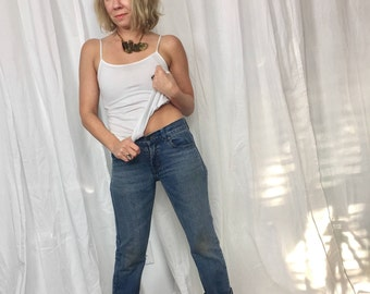Levis 505 Weathered Denim Delight in size xs 25 waist